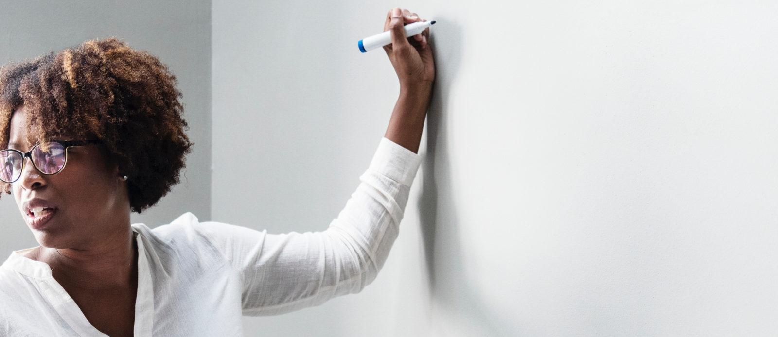 Teacher Writes on White Board